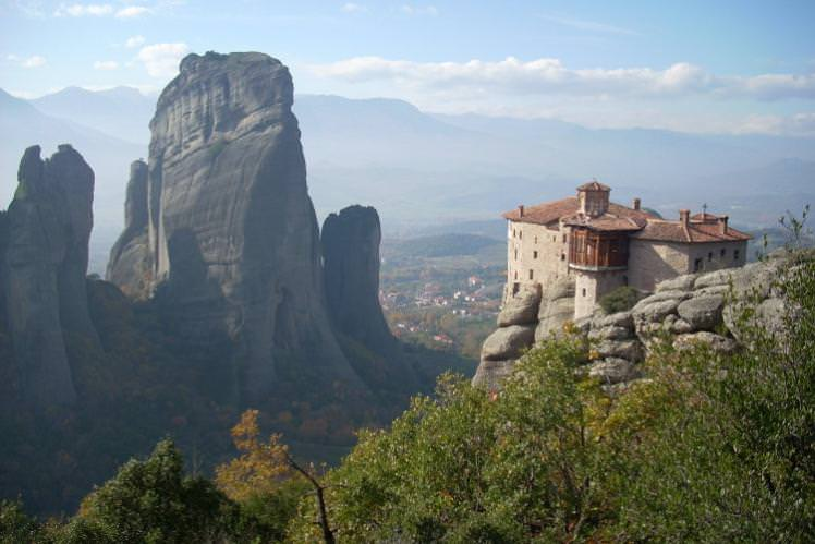 Monasteries perch on rocky pinnacles at central Greece's Meteora. Image by Alexis Averbuck / Lonely Planet