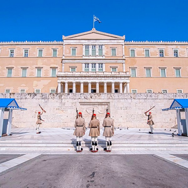 The Hellenic Parliament building in Athens, Greece an ASIT tour sight. It is guarded by 3 soldiers.