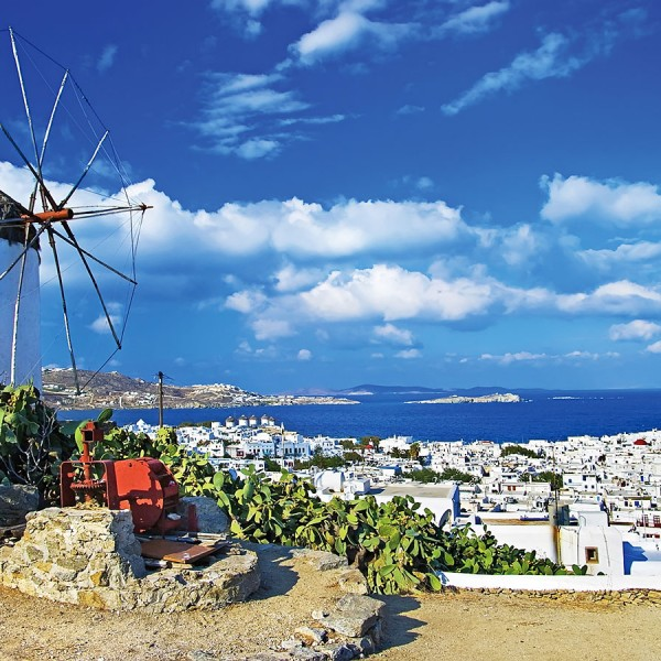 Windmill above whitewashed Mykonos town, a stop on the 3 day Athens, Greek islands & Turkey cruise