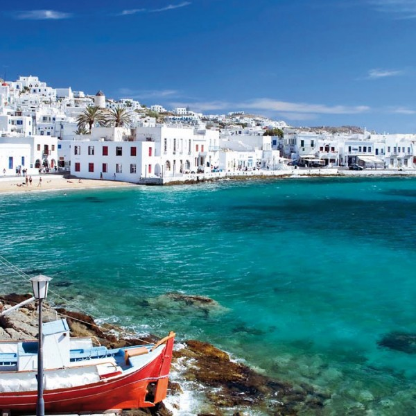 Mykonos town harbour with houses & fishing boat. This Greek island is a stop on ASIT's 7 day cruise
