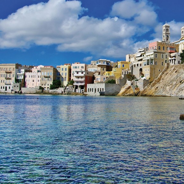 Ermoupoli & St. Nicholas church seen from the beach in Syros on the ASIT 7 day Greek island cruise