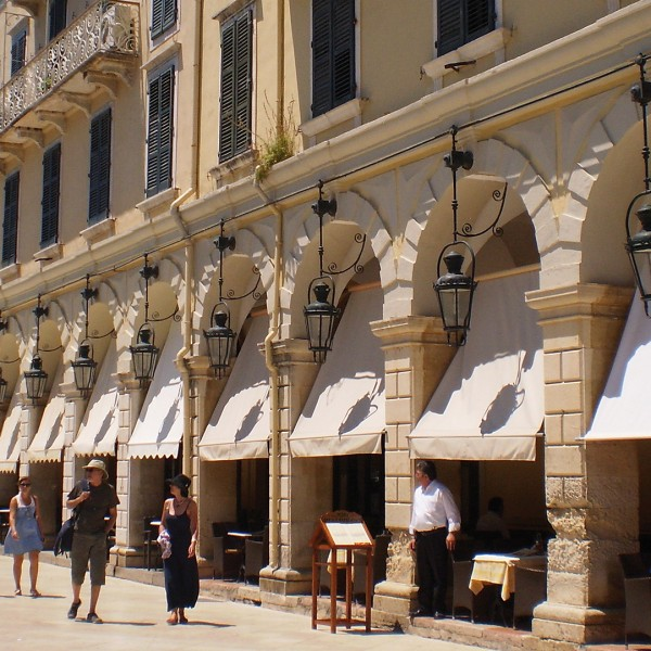 Visitors explore an elegant street in Corfu town, an essential part of ASIT's 6 day tour package