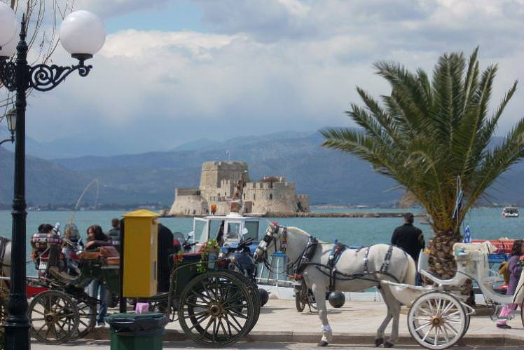 Carriages quayside in the historic Venetian town of Nafplio in the Peloponnese. Image by Alexis Averbuck / Lonely Planet