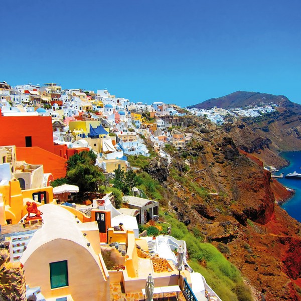 Colourful houses on the edge of Santorini island's caldera, a vacation package destination from ASIT