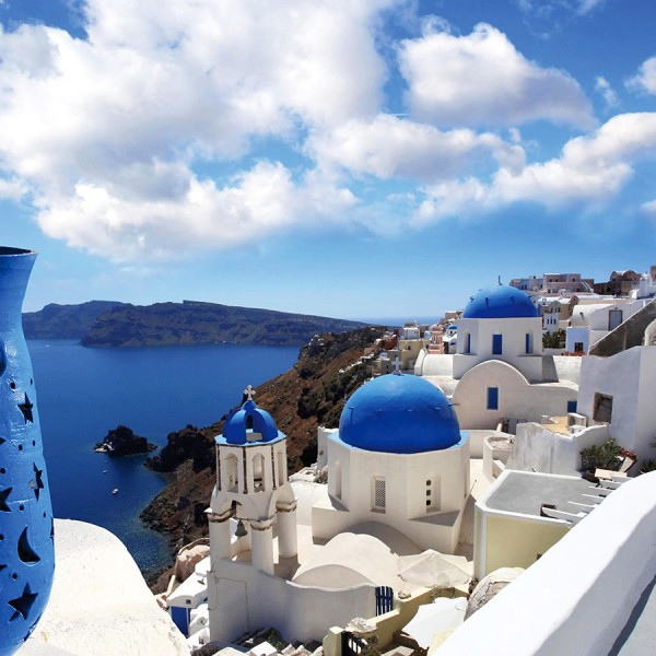 Decorative blue vase, blue domed churches & sea view from the Greek island of Santorini.