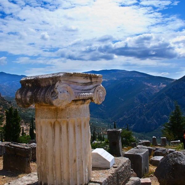 A column & mountain view at the ancient temple of Delphi, part of the ASIT 5 day Athens Meteora tour