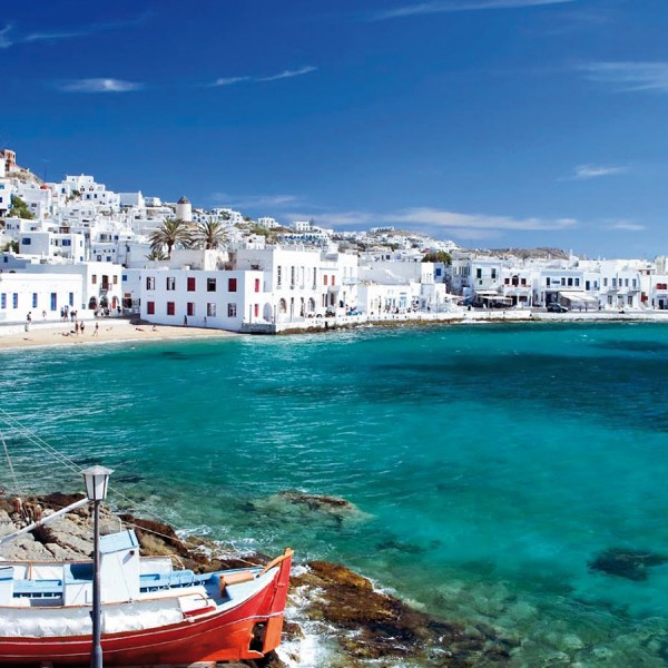 Fishing boats in a harbour in Mykonos, a destination on ASIT's round trip vacation from Athens