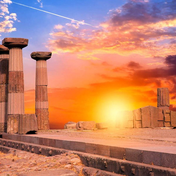 Sunset behind columns & ancient ruins in Athens, a leg of the ASIT 7 day Rhodes island vacation trip