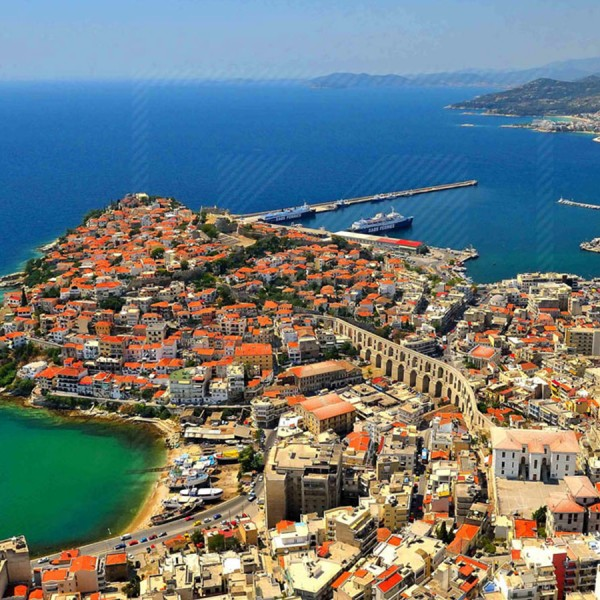 Aerial view of Kavala town, the historic aqueduct, & the sea. A stop on ASIT's Best of Greece tour.