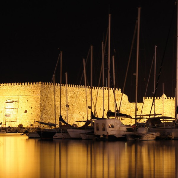 The Fortress in Heraklion harbour at night. Crete is a stop on ASIT's Greek island & Turkey cruise