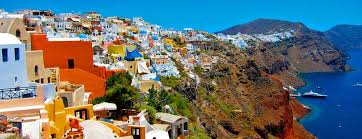Colourful sprawl of houses on the side of the volcanic caldera on the Greek island of Santorini