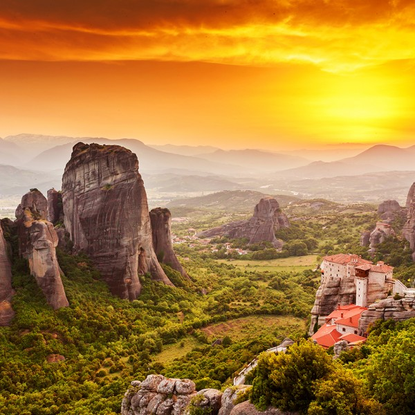 Sunset over the beautiful monastery at Meteora, a stop on the ASIT 8 day Greece tour package.