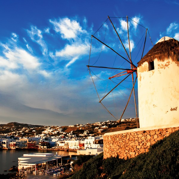Mykonos' famous windmills by the sea, one of the attractions on the ASIT Mykonos vacation package